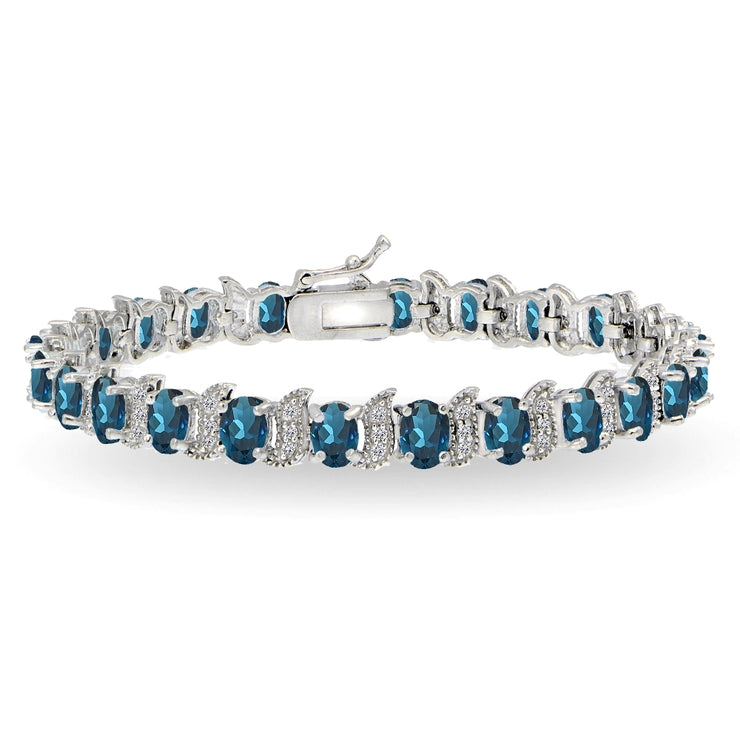 Sterling Silver London Blue Topaz 6x4mm Oval and S Tennis Bracelet with White Topaz Accents