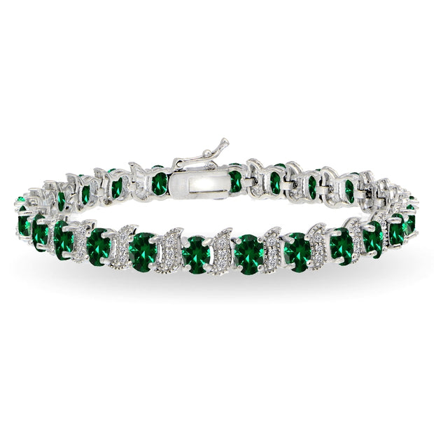 Sterling Silver Created Emerald 6x4mm Oval and S Tennis Bracelet with White Topaz Accents