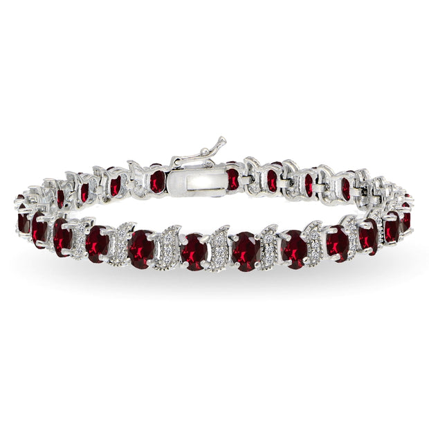 Sterling Silver Created Ruby 6x4mm Oval and S Tennis Bracelet with White Topaz Accents