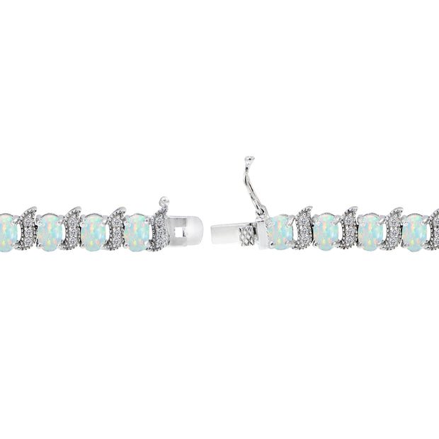 Sterling Silver Created White Opal 6x4mm Oval and S Tennis Bracelet with White Topaz Accents