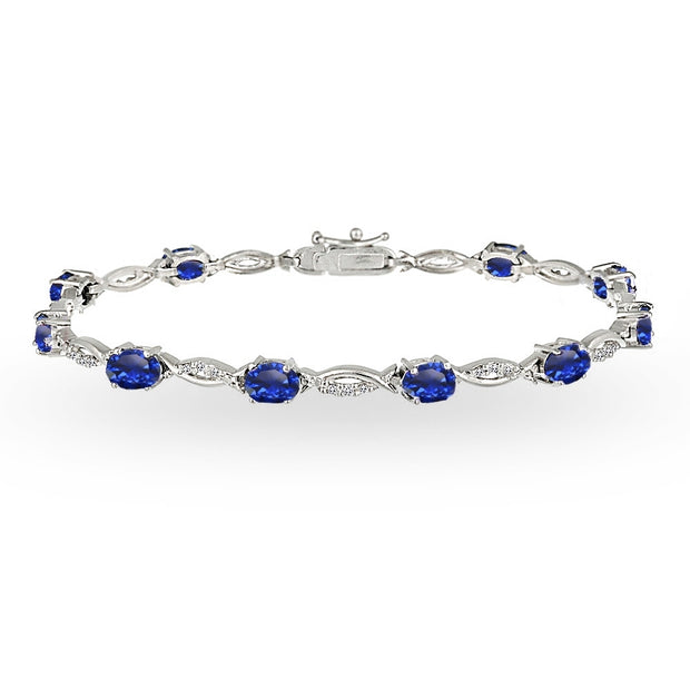 Sterling Silver Created Blue Sapphire and White Topaz Oval-Cut Swirl Tennis Bracelet