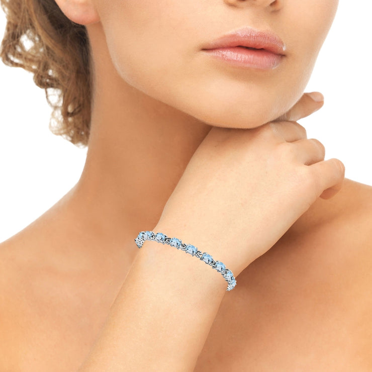 Sterling Silver Polished Blue Topaz 6x4mm Oval-cut Link Tennis Bracelet