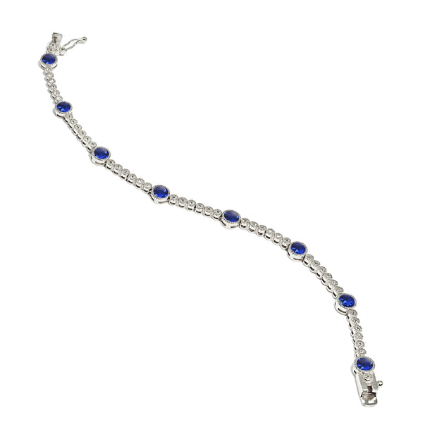 Sterling Silver Created Blue Sapphire & White Topaz Round Halo Tennis Bracelet