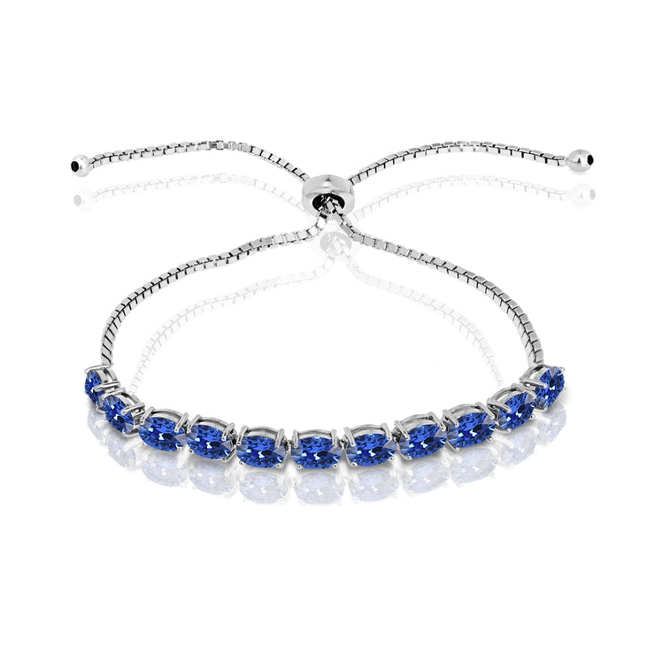 Sterling Silver Blue 6x4mm Oval-Cut Pull-String Adjustable Bolo Bracelet Made with Swarovski Crystals