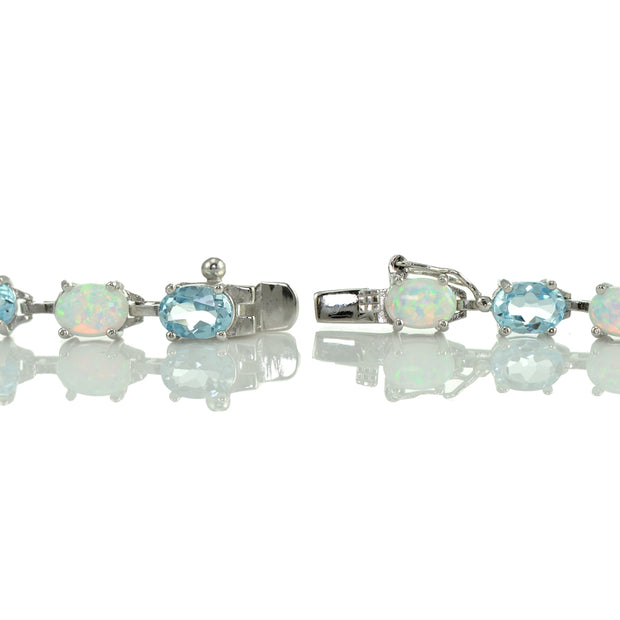 Sterlilng Silver Blue Topaz and Created White Opal 7x5mm Oval-Cut Tennis Bracelet