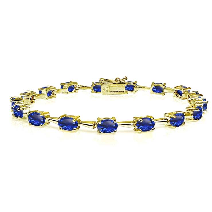 Yellow Gold Flashed Sterling Silver Created Blue Sapphire 6x4mm Oval Classic Link Tennis Bracelet