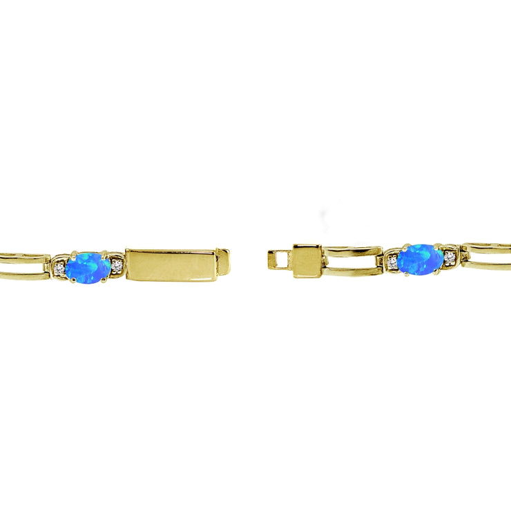 Yellow Gold Flashed Sterling Silver Created Blue Opal and Cubic Zirconia Oval & Bar Link Bracelet