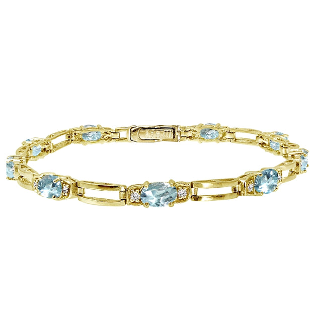 Yellow Gold Flashed Sterling Silver Blue Topaz and Cubic Zirconia Oval & Bar Link Bracelet