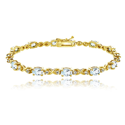Yellow Gold Plated Sterling Silver Blue Topaz 6x4mm Oval Infinity Bracelet with White Topaz Accents