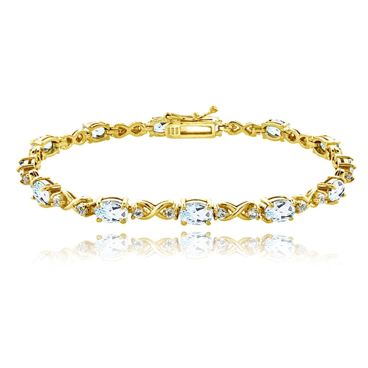 Yellow Gold Flashed Sterling Silver Blue Topaz 6x4mm Oval Infinity Bracelet with White Topaz Accents