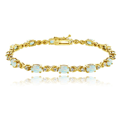 Yellow Gold Flashed Sterling Silver Simulated White Opal 6x4mm Oval Infinity Bracelet with White Topaz Accents