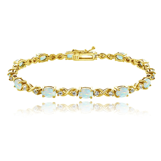 Yellow Gold Plated Sterling Silver Simulated White Opal 6x4mm Oval Infinity Bracelet with White Topaz Accents