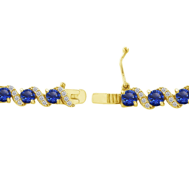 Yellow Gold Flashed Sterling Silver Created Blue Sapphire 4mm Round-Cut S Design Tennis Bracelet with White Topaz Accents