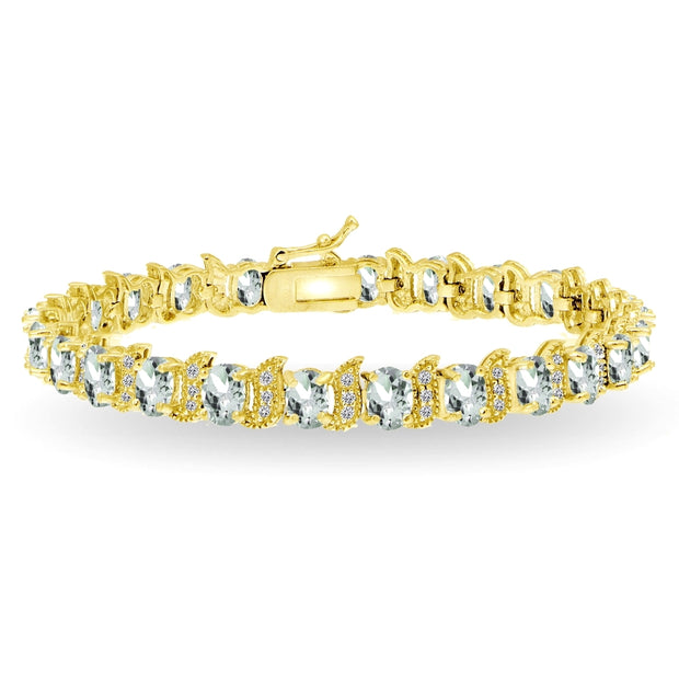 Yellow Gold Flashed Sterling Silver Aquamarine 6x4mm Oval and S Tennis Bracelet with White Topaz Accents