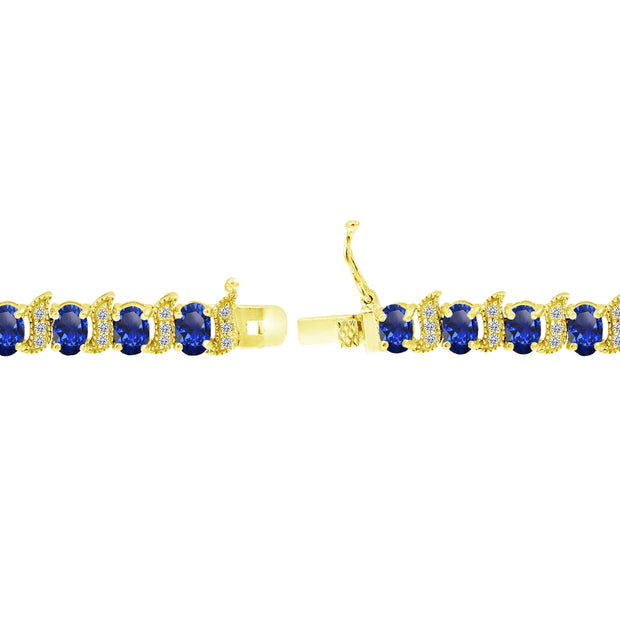 Yellow Gold Flashed Sterling Silver Created Blue Sapphire 6x4mm Oval and S Tennis Bracelet with White Topaz Accents