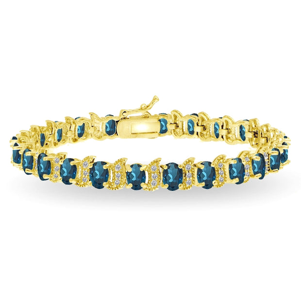 Yellow Gold Flashed Sterling Silver London Blue Topaz 6x4mm Oval and S Tennis Bracelet with White Topaz Accents