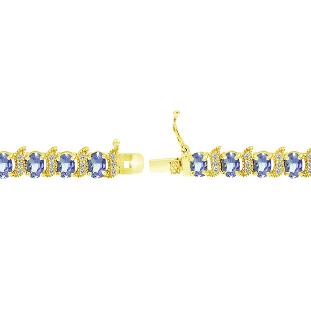 Yellow Gold Flashed Sterling Silver Tanzanite 6x4mm Oval and S Tennis Bracelet with White Topaz Accents