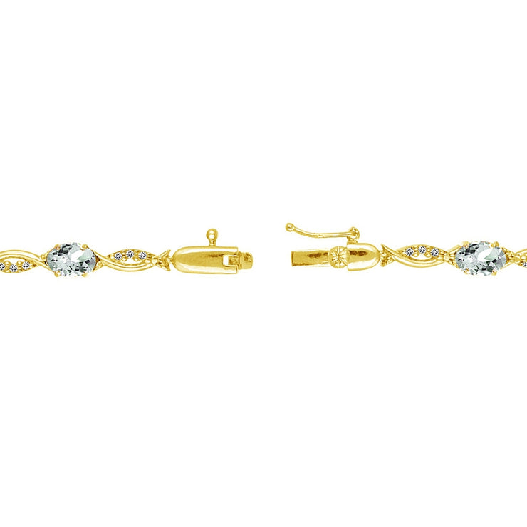 Yellow Gold Flashed Sterling Silver Aquamarine and White Topaz Oval-Cut Swirl Tennis Bracelet