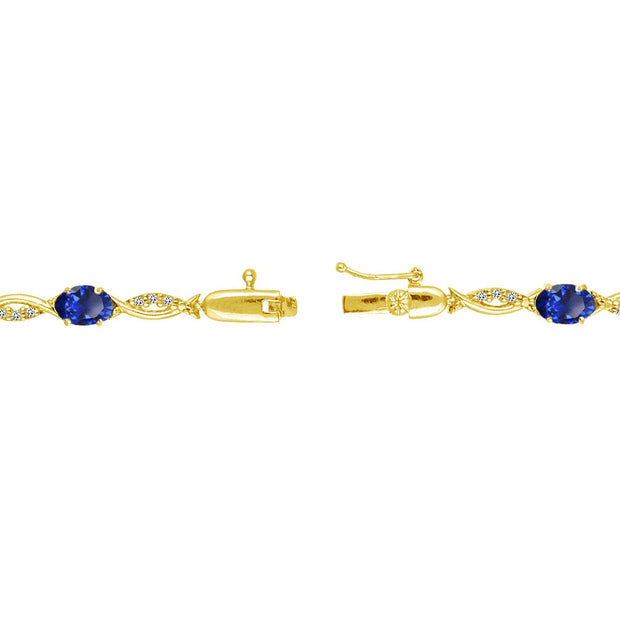 Yellow Gold Flashed Sterling Silver Created Blue Sapphire and White Topaz Oval-Cut Swirl Tennis Bracelet