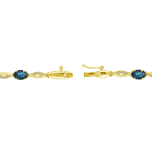 Yellow Gold Flashed Sterling Silver London Blue and White Topaz Oval-Cut Swirl Tennis Bracelet