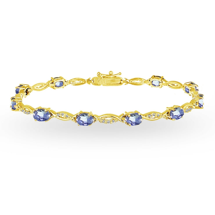 Yellow Gold Flashed Sterling Silver Tanzanite and White Topaz Oval-Cut Swirl Tennis Bracelet