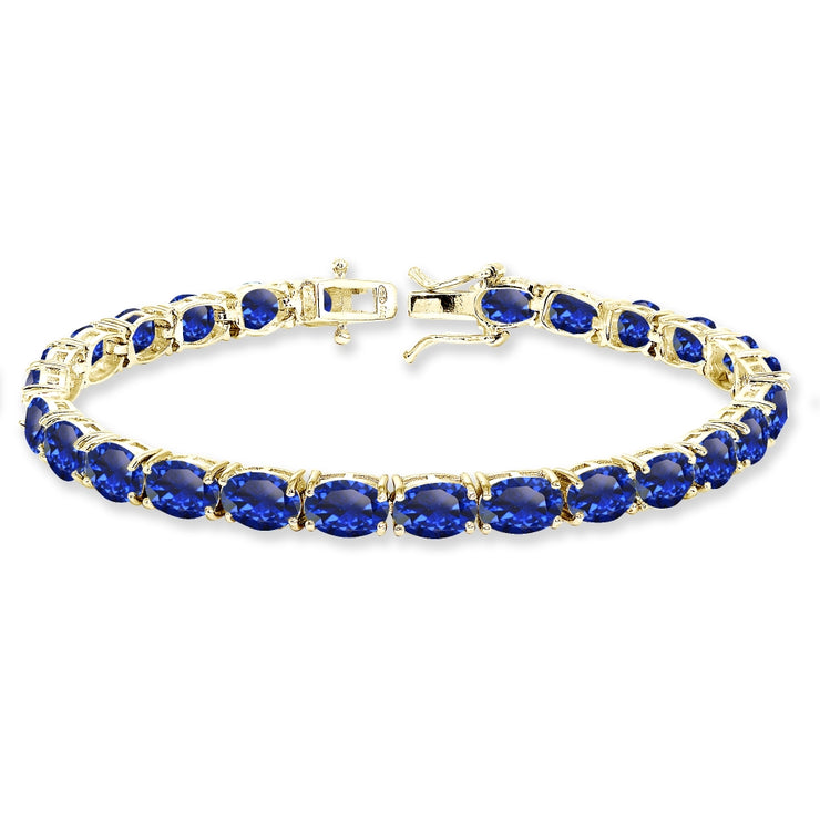 Yellow Gold Flashed Sterling Silver 7x5mm Created Blue Sapphire Oval-cut Classic Tennis Bracelet