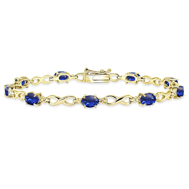 Yellow Gold Flashed Sterling Silver Created Blue Sapphire Oval Polished Infinity Classic Tennis Bracelet