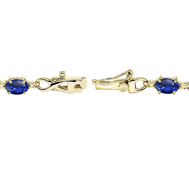 Yellow Gold Plated Sterling Silver Created Blue Sapphire Oval Polished Infinity Classic Tennis Bracelet