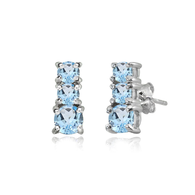 Sterling Silver Blue Topaz Round Graduating Three Stone Stud Earrings
