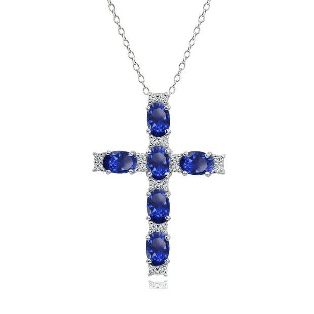 Sterling Silver Created Blue Sapphire Oval-Cut Cross Pendant Necklace with White Topaz Accents