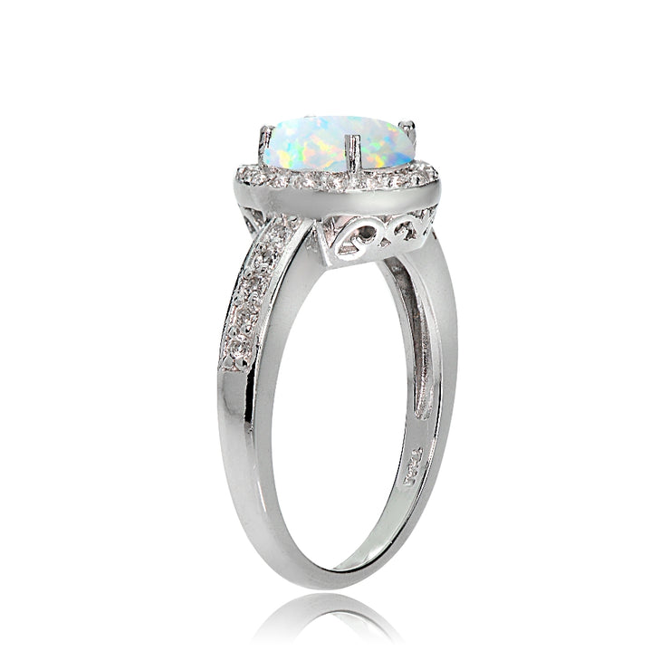 Sterling Silver Created Opal and White Topaz Oval Halo Ring