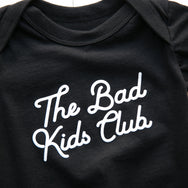"""THE BAD KIDS CLUB"" ONESIE BLACK"