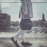 woman walking with luxury leather bag, luxury leather bag, italian calf leather bag, fashion bag