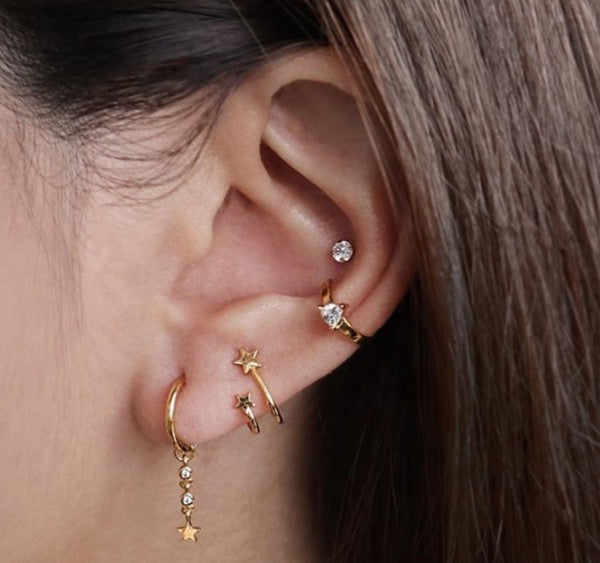 Star golf earrings stack
