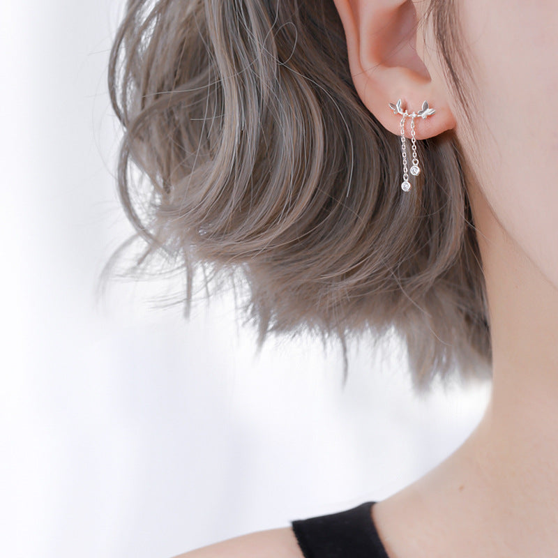 silver tinny butterfly earrings on model