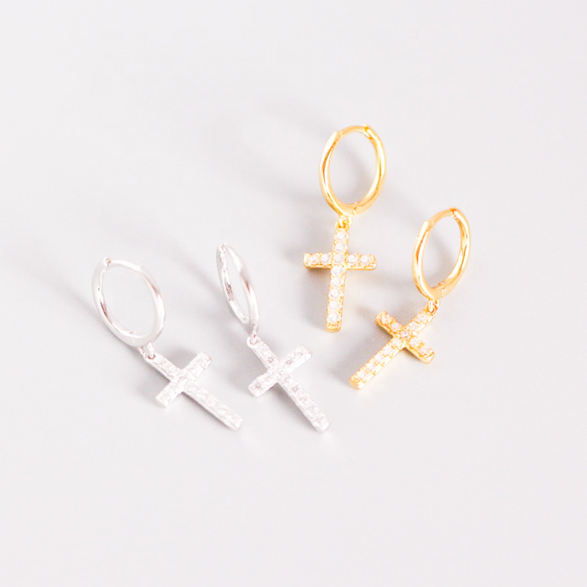 gold and silver earrings with crosses