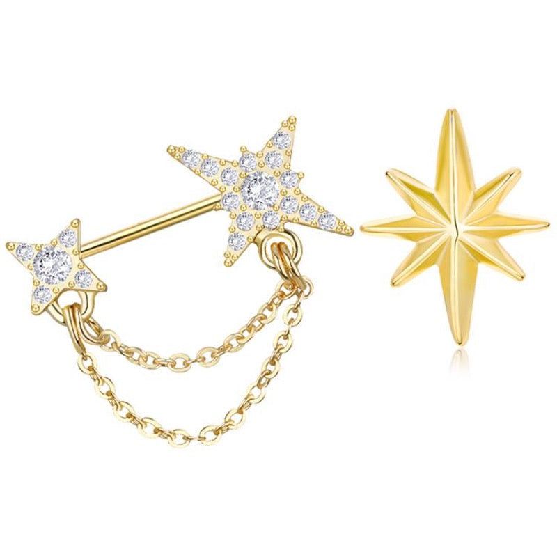 asymmetric gold earrings one with 2 stars and crystals and one simple star no crystals