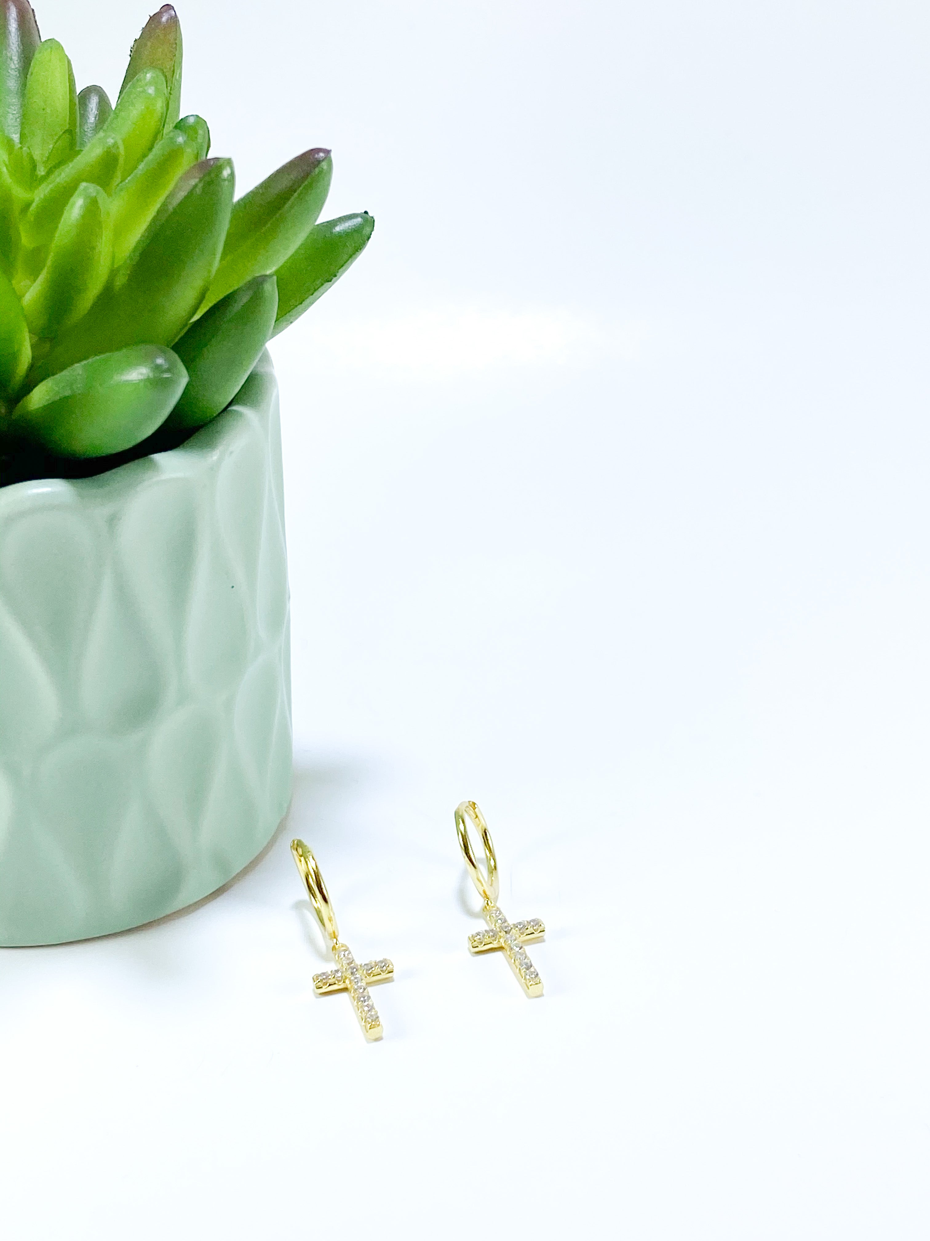 gold earrings with crosses