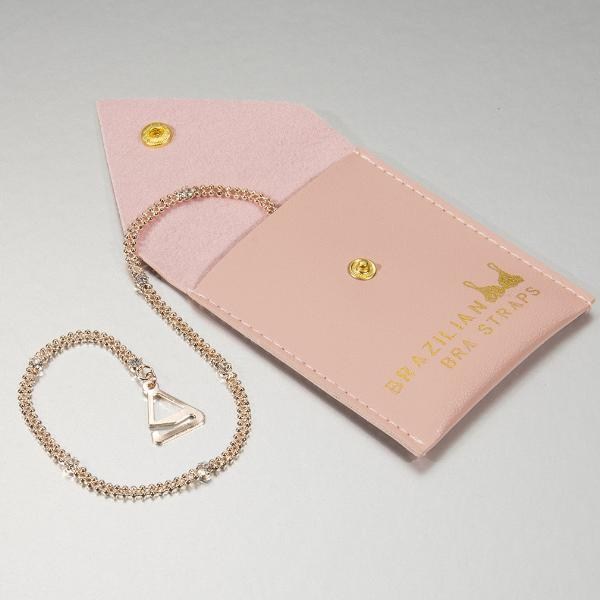 rose gold plated bra straps on gift pouch