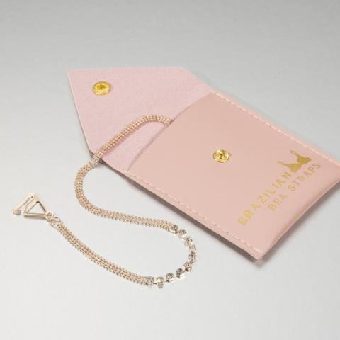 rose gold bra straps in pink pouch for gifts