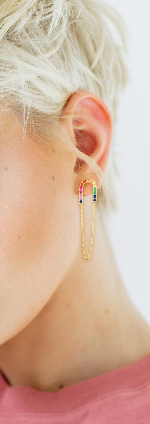 Rainbow gold earrings on model