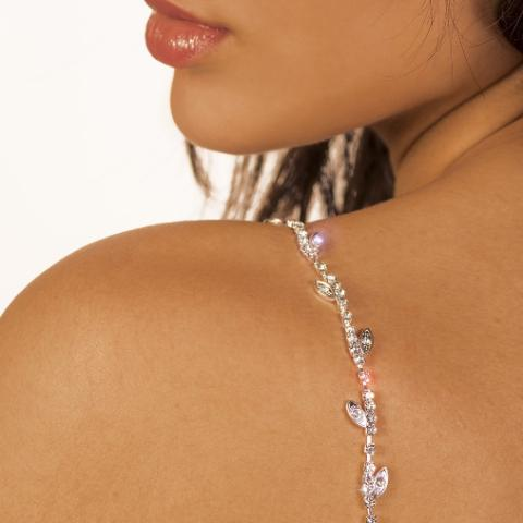 silver bra straps on medium skin