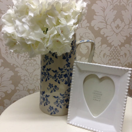 White ceramic heart picture frame