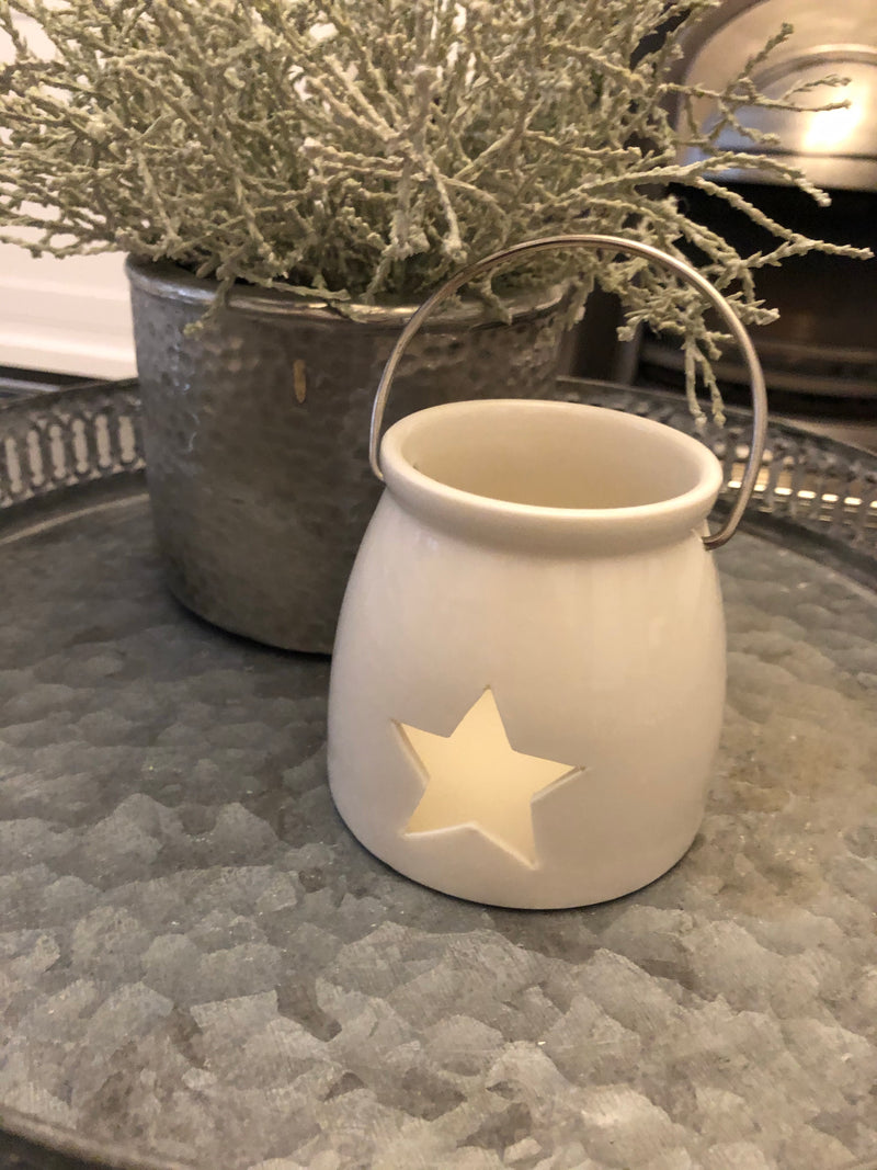 White ceramic star tea light holder with metal handle 9cm