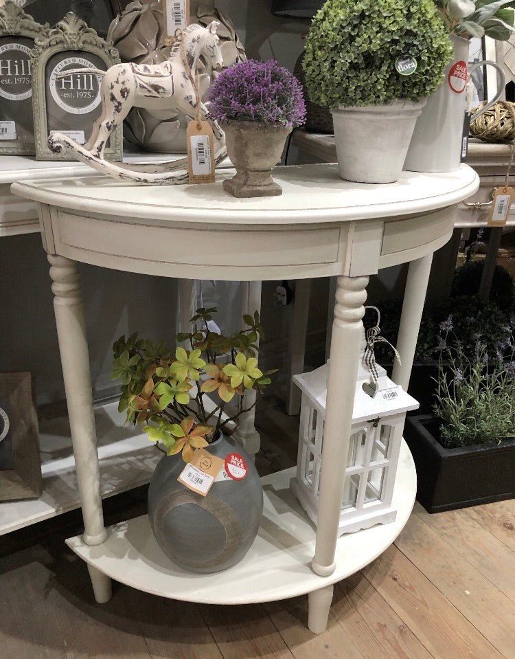 Store seconds off white half moon table
