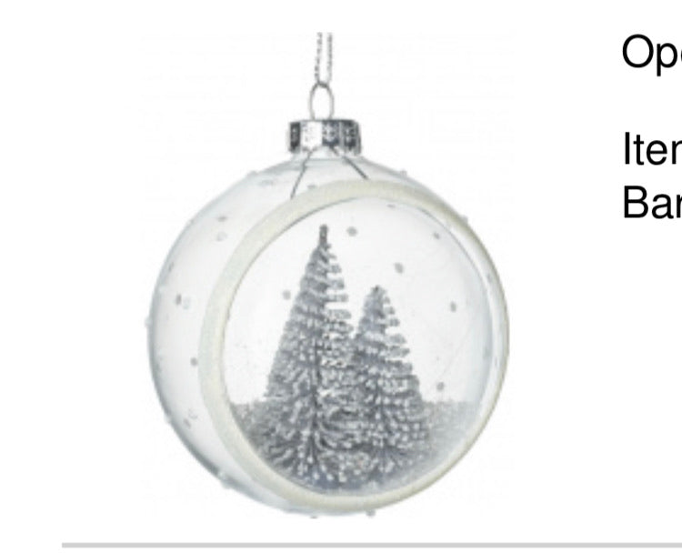 Open glass bauble with snowy tree