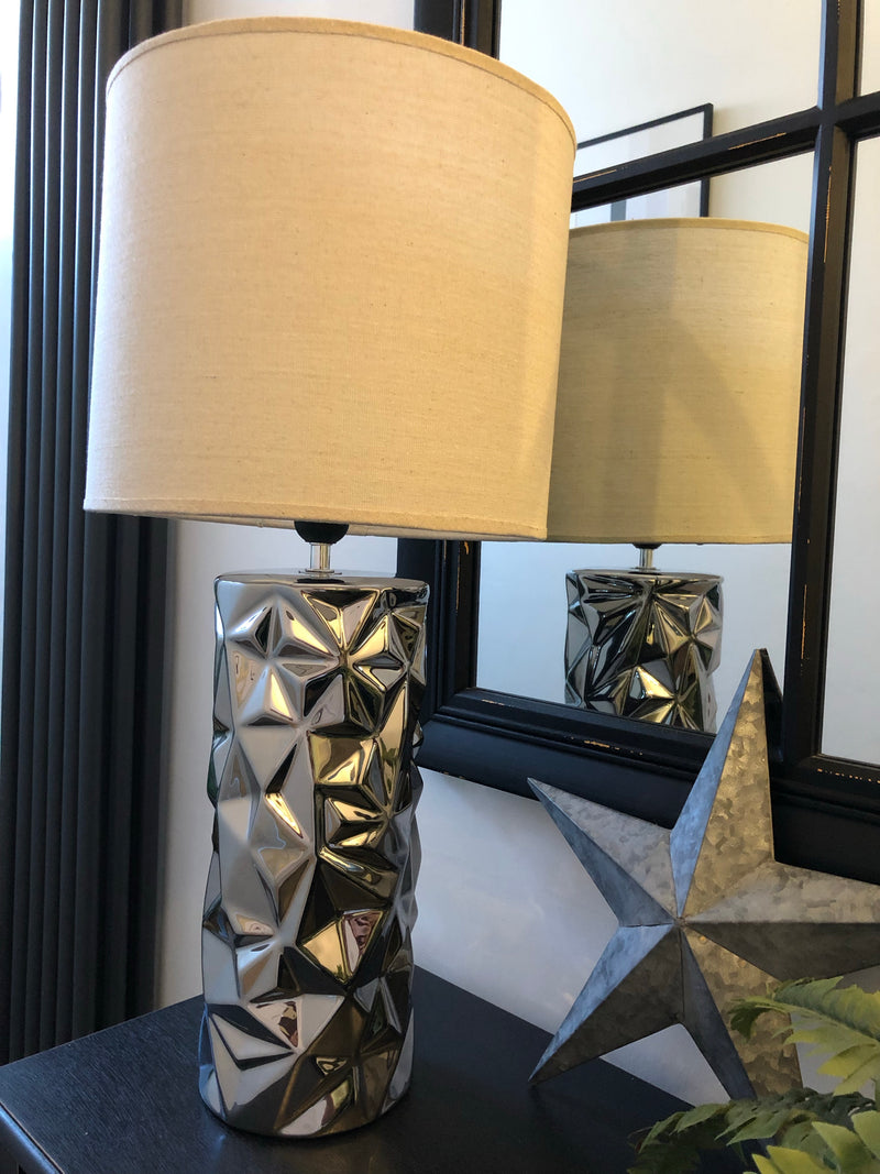 Tall silver table lamp with natural shade
