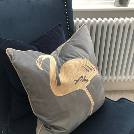 Grey and gold embroidered flamingo cushion