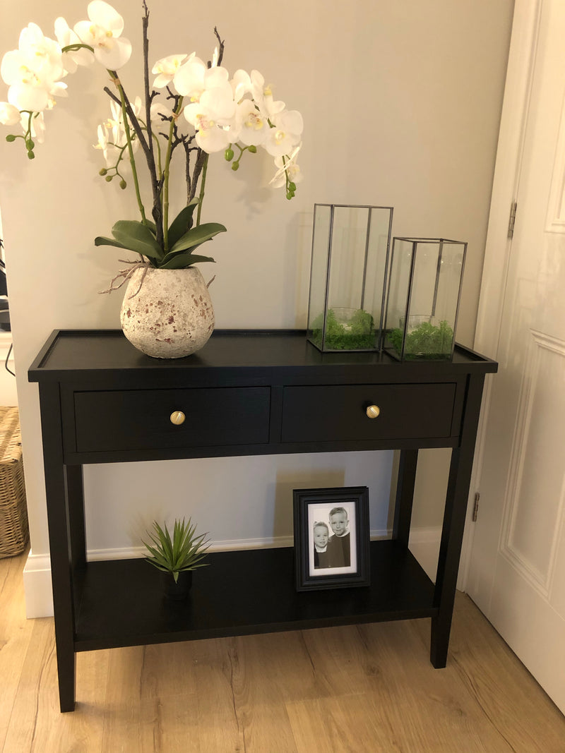 Store seconds black console table