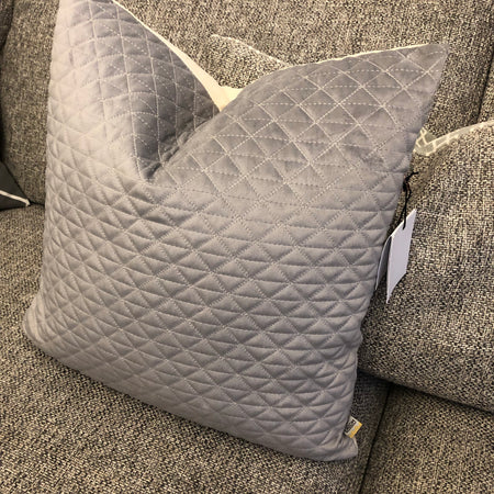 Quilted grey cushion with feather inner